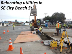 Relocating utilities in SE City Beach St