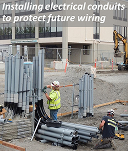 Installing electrical conduits to protect future wiring.