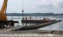 Removing the barge from Oak Harbor Bay