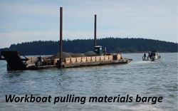 Workboat pulling materials barge